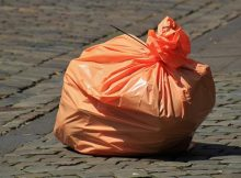 UK's strategy of double-charging on plastic bags extended to all shops